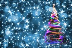 Julgran från färgljus Arkivfoto