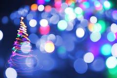 Julgran från färgljus Royaltyfri Foto