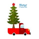 Julgran i bil Lastbilen bär den dekorerade julgranen fo Arkivbild