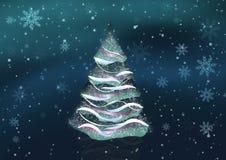 Julgran i snow Arkivfoto
