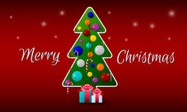 Julgran med bollar och godis på en röd bakgrund med hälsningar Royaltyfri Bild
