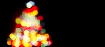 Julgran med Defocused felikt ljus Fotografering för Bildbyråer