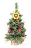 Julgran med prydnader och kottar på vit bakgrund Royaltyfri Bild