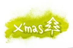 Julgran med pudrat grönt te arkivbilder