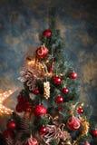 Julgran med röda och gula garneringar Fotografering för Bildbyråer