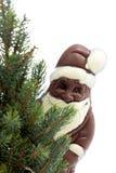 Julgran och choklad Santa Claus mot det vita bakgrundsslutet upp Royaltyfri Bild