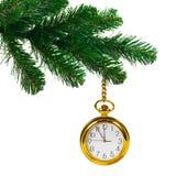 Julgran och klocka arkivbild