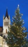 Julgran och kyrkligt torn med blå himmel Royaltyfria Foton