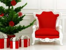 Julgran och röd fåtölj Royaltyfri Bild