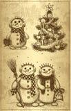 Julgran och snögubbe som dras av handen Arkivbilder