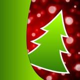 Julgran på röd snöflingabakgrund Arkivbild
