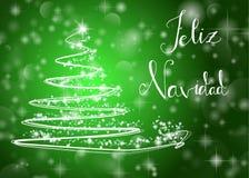 Julgran på skinande grön bakgrund med handstilen Arkivbild