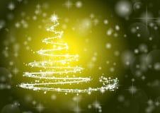 Julgran på skinande guling/mörk bakgrund Arkivfoto