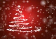 Julgran på skinande röd bakgrund Arkivbild