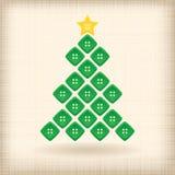 Julgran som göras av knappar Arkivbild