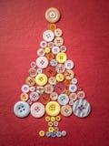 Julgran som göras av knappar Royaltyfria Bilder