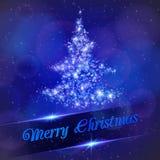 Julgran som göras av ljusa partiklar. Arkivfoto