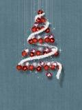 Julgran som göras av prydnader på blått texturerad bakgrund Arkivbilder