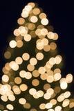 Julgranbokeh som skjutas som bakgrund Arkivfoton