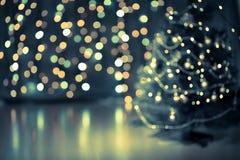 Julgranbokehbakgrund Fotografering för Bildbyråer