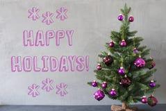 Julgranen cementvägg, smsar lyckliga ferier Royaltyfri Bild