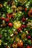 Julgranen smyckar garneringar som firar ferier royaltyfri fotografi