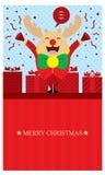 Julhälsningar med renen Arkivbild