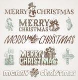 Julhälsningar och tecken Arkivfoto