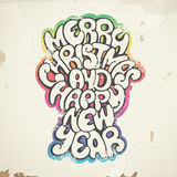 Julhälsningar, sprej som målas, på den gamla väggen. Fotografering för Bildbyråer