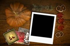 Julhälsningkort, en tom ögonblicklig fotoram Arkivfoton