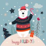 Julhälsningkort med den vita björnen på en vinterbakgrund Royaltyfria Bilder