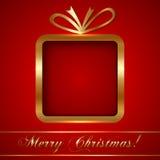 Julhälsningkort med gåvan Arkivfoto
