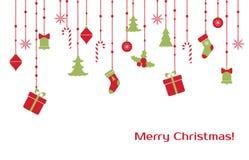 Julhälsningkort med hängande leksaker Arkivbild