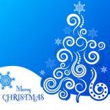 Julhälsningkort på en blå bakgrund Royaltyfria Bilder