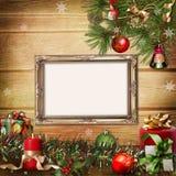 Julhälsningskortet med inramar för en familj Fotografering för Bildbyråer