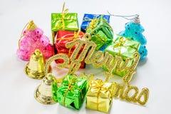 julhelgdagsaftongåvor semestrar många prydnadar Arkivfoto