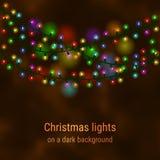 Julhusljus på en mörk bakgrund Royaltyfria Bilder
