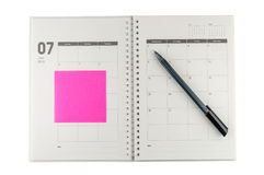 2014 Juli-organisator met pen & post-it. royalty-vrije stock afbeelding
