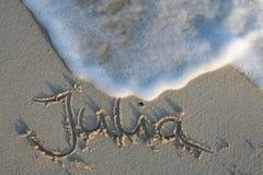 Julia - Name im Sand Lizenzfreie Stockbilder