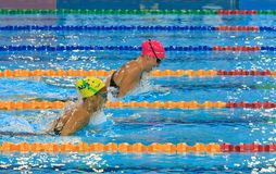 Julia Smit. In the pink cap wins the 200m IM event by holding off Kotuku Ngawati of Australia Royalty Free Stock Image