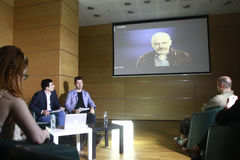 Julian Assange conference. BUCHAREST, ROMANIA - MAY 19, 2015: WikiLeaks founder Julian Assange speaks via a web conference about press freedom and democracy Royalty Free Stock Photos