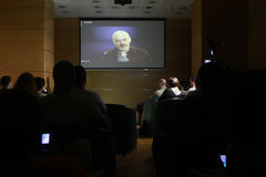 Julian Assange conference. BUCHAREST, ROMANIA - MAY 19, 2015: WikiLeaks founder Julian Assange speaks via a web conference about press freedom and democracy Royalty Free Stock Photography