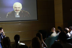 Julian Assange conference. BUCHAREST, ROMANIA - MAY 19, 2015: WikiLeaks founder Julian Assange speaks via a web conference about press freedom and democracy Royalty Free Stock Image