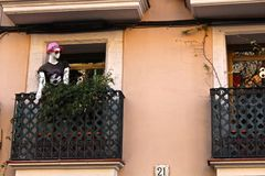 Julian Capulet. A male mannequin in a t shirt and pink hat on a balcony window in Barcelona, Spain royalty free stock photo