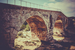 Julien bridge in Provence, France. Old roman bridge Julien pont in Provence, France. Filtered shot Stock Images