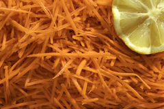 Julienne carrots salade. Julienne shredded carrots salade background Stock Image