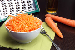 Julienne carrots in white bowl Stock Photo