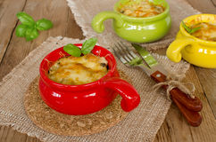 Julienne with chicken and mushrooms under a cheese crust Royalty Free Stock Images