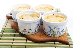 Julienne with hen and mushrooms covered with much cheese Stock Photos