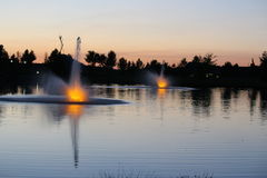 Julius M Kleiner Memorial Park at Twilight. Twilight at beautiful Julius M Kleiner Memorial Park at twilight. Peaceful reflecting ponds with lit fountains Royalty Free Stock Photos